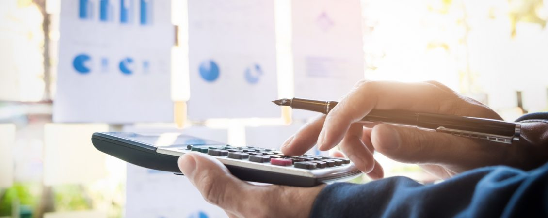 business-finance-man-calculating-budget-numbers-invoices-and-financial-adviser-working