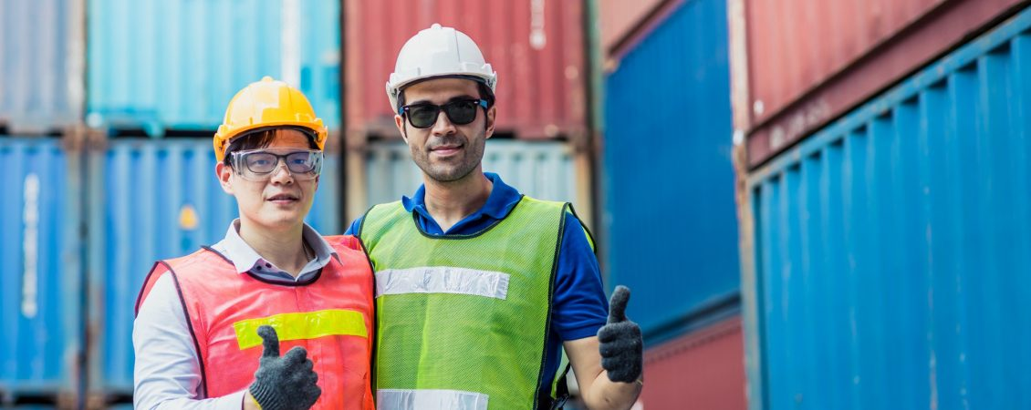 staff-and-foreman-control-loading-container-cargo-working-team-happy-enjoy-working-standing-smile-hand-show-thumbs-up
